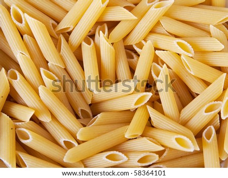 macro closeup of penne pasta background texture - stock photo