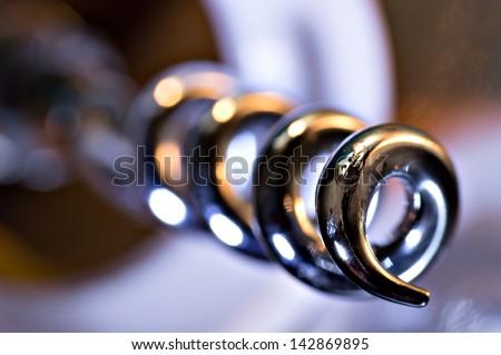 Macro closeup on a corkscrew. - stock photo