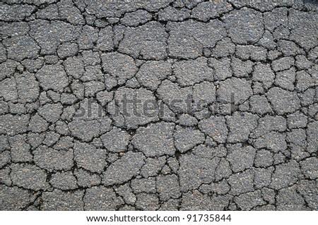 Macro closeup on concrete asphalt cracks on the road - stock photo