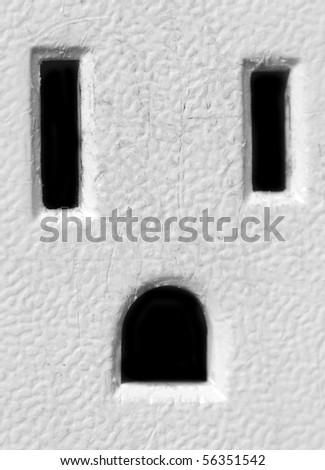 Macro closeup photograph of an American electricity outlet. - stock photo