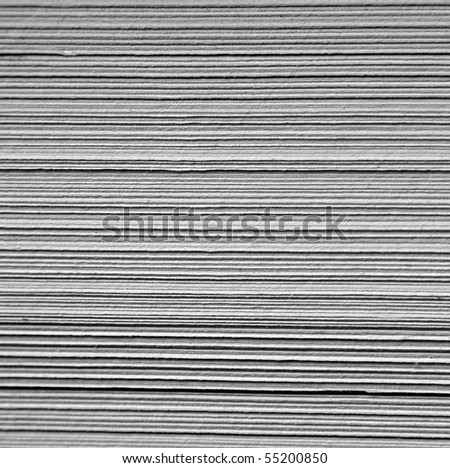 Macro closeup photograph of pages in a book. This is so closeup that it looks like cardboard or cardstock. - stock photo