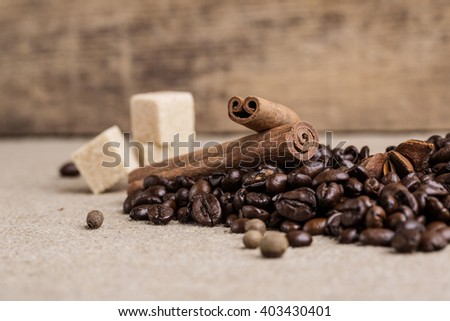 macro coffee cinnamon cane sugar star anise on the vintage table - stock photo