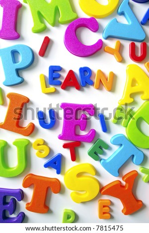 Macro composition of colorful plastic toy letters with the word LEARN
