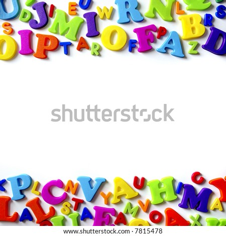 Macro composition of many colorful plastic toy letters - stock photo