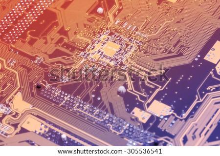 Macro computer motherboard techology background vintage gradient - stock photo