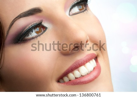 Macro cosmetic portrait of attractive young woman. - stock photo