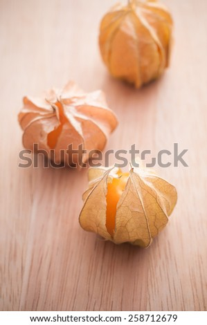 Macro detail image of Cape gooseberry on wooden background - stock photo