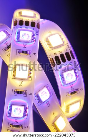 macro detail of a RGB-LED-stripe combined with warmwhite LEDs in colored spotlight  - stock photo