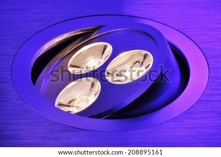 macro detail of a warmwhite triple-LED in violet spotlight  - stock photo