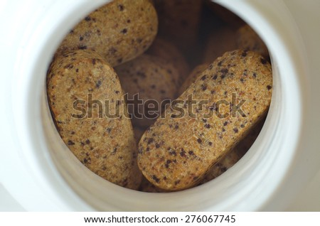 Macro detail of bottle of multivitamin supplement pills  - stock photo