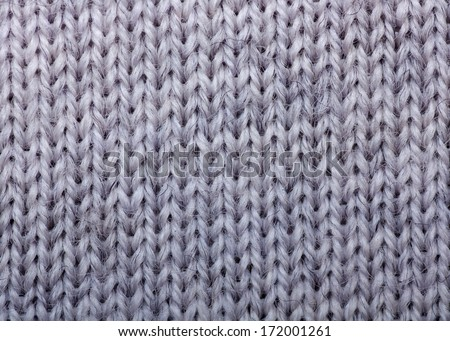 Macro detail of gray knitted wool texture or background - stock photo