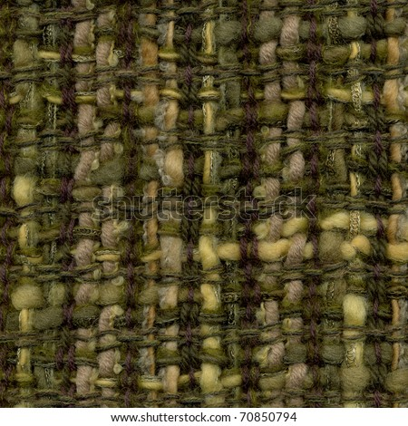 Macro detail of handwoven woolen fabric in brown and green - stock photo