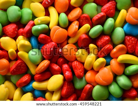 Macro detail of pile of coloured chocolate sweets - stock photo