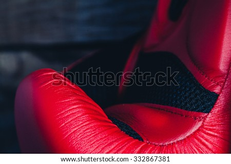 Macro detail of red boxing gloves. - stock photo