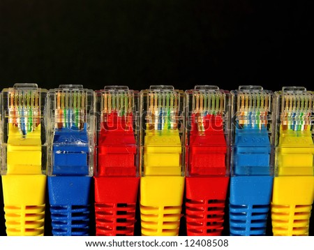 macro detail of rj45 conectors on black background - stock photo
