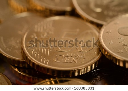 Macro euro coins piled isolated