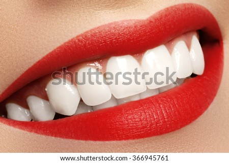 Macro happy woman's smile with healthy white teeth. Lips make-up. Stomatology and beauty care. Woman smiling with great teeth. Cheerful female smile with fresh clear skin - stock photo