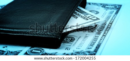 Macro image of a black leather wallet - stock photo