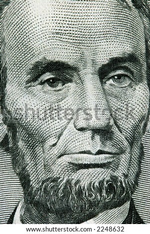 Macro image of a five dollar bill with Benjamin Franklin