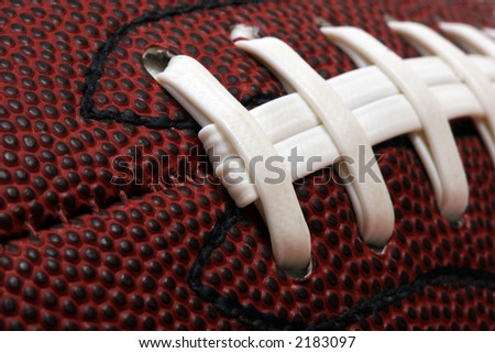 Macro image of american football - stock photo