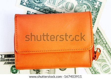 Macro  image of an orange  leather wallet - stock photo