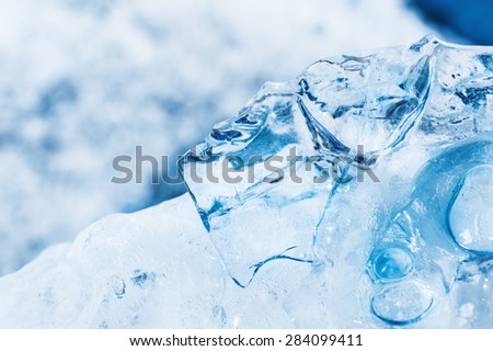 Macro image of blue ice with small depth of field. Ice background - stock photo