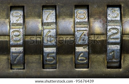 macro image of brass combination lock with the number set to 8672