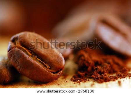 Macro image of coffee beans and ground coffee
