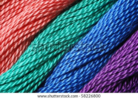Macro image of colorful cotton craft thread with diagonal design. - stock photo