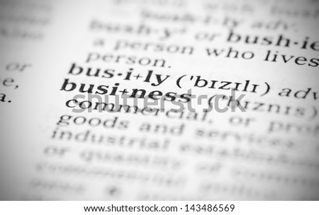 Macro image of dictionary definition of word  business - stock photo