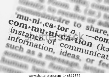 Macro image of dictionary definition of word communication