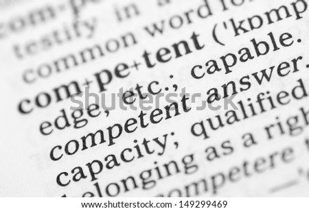Macro image of dictionary definition of word competent - stock photo