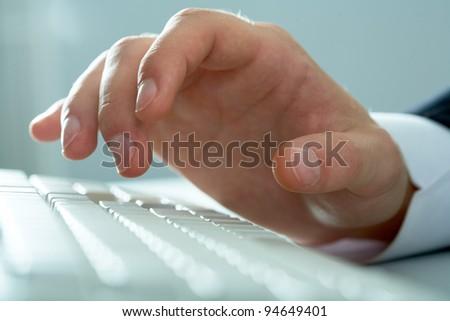 Macro image of human hand over keyboard - stock photo