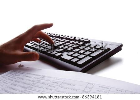 Macro image of human hands typing on keyboard isolated - stock photo