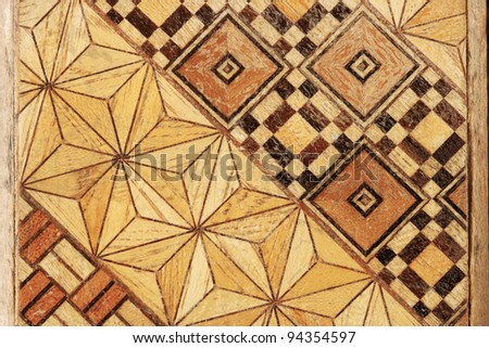 macro image of inlaid abstract geometric wood marquetry pattern