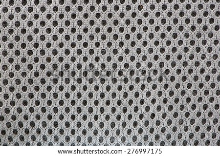 macro image of open textured woven fabric showing the individual threads and holes as a background - stock photo