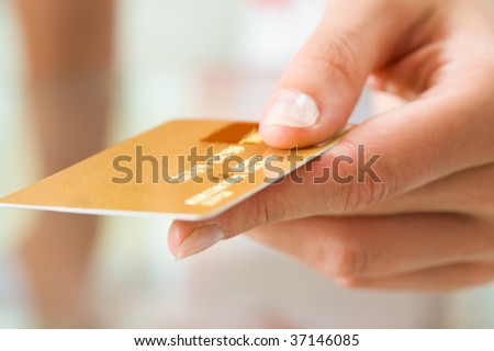 Macro image of plastic card in human hand