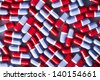 Macro image of Red and blue tablets texture - stock photo