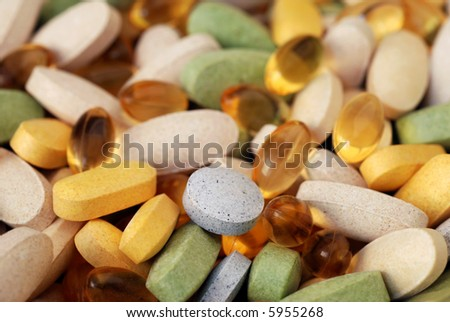 Macro image of various vitamins and nutritional supplements in natural sunlight with shallow dof. - stock photo