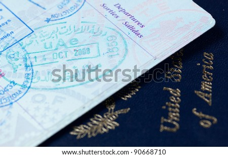 Macro image of visa and immigration stamps in US passport for Dubai or Abu Dhabi in the UAE - stock photo