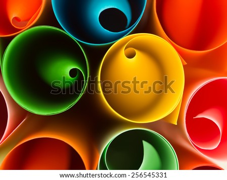macro image, top view of group of rolled up colorful sheets of paper - stock photo