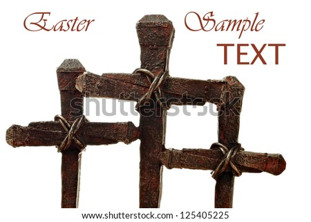 Macro images of rusty nail crosses on white background with copy space. - stock photo