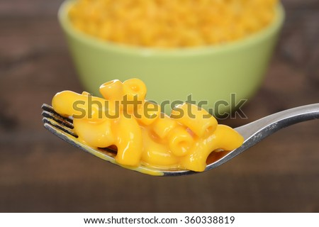 macro macaroni and cheese on a fork - stock photo