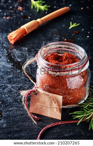 Macro Marinade Powder Container with Small Brush on Vintage Table. Used in Adding Meat Flavors. - stock photo