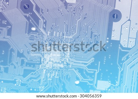 Macro motherboard blurry techology background blue colorful filtered - stock photo