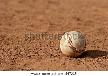 macro of a baseball lost on the field