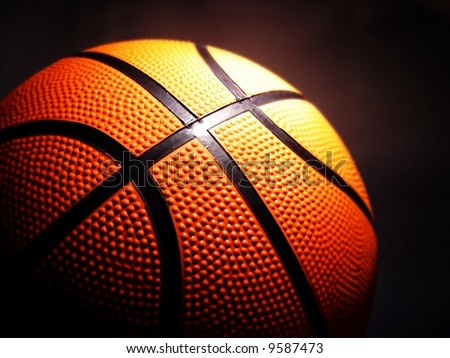 macro of a basketball against a black background