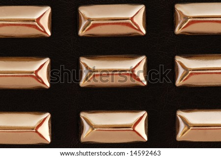 Macro of a Black Leather Belt with Chrome Studs - stock photo