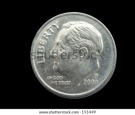 Macro of a $.10 cent coin on black background - stock photo