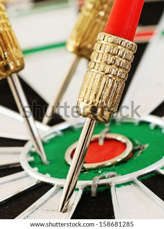 Macro of a Dart in a Dartboard - stock photo